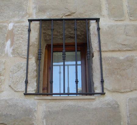 Modelos de protectores de puertas y ventana tattoo for Modelos de puertas de herreria